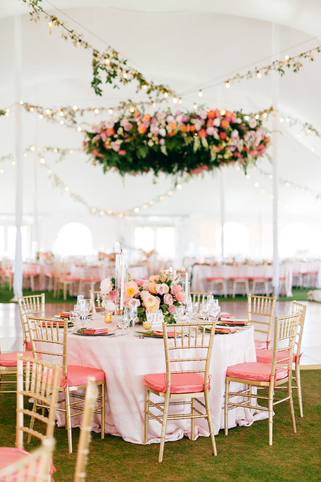 Elegant Tropical Tent Wedding Reception Decor, Tables with White Linens, Gold Chiavari Chairs with Pink Cushions, Hanging Floral Draping   Tampa Bay Wedding Planner NK Weddings