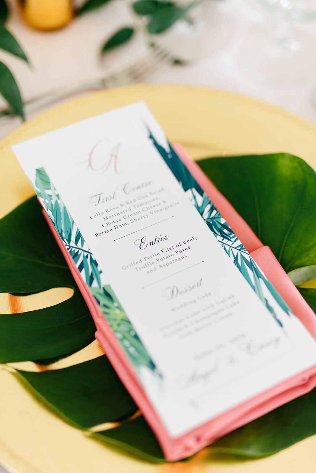 Elegant Tropical Wedding Reception Decor, Custom Menu, Monstera Leaf and Gold Charger   Tampa Bay Wedding Planner NK Weddings