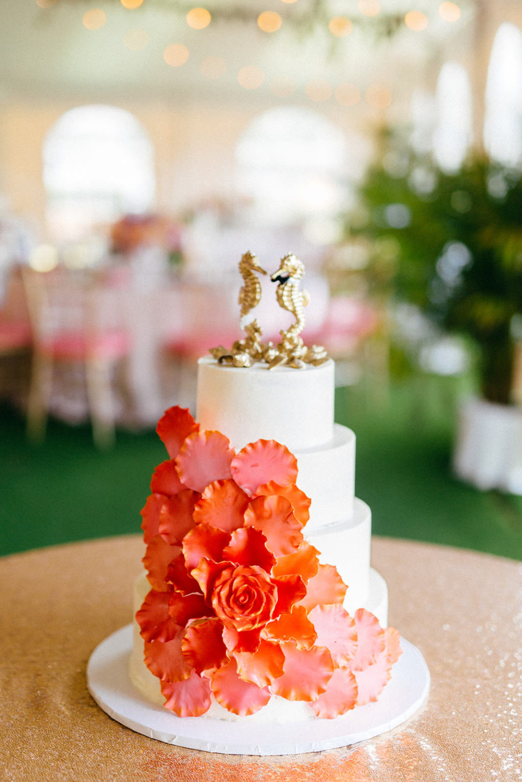 Tropical Elegant Four Tier White Wedding Cake with Coral Sugar Flowers Cascading