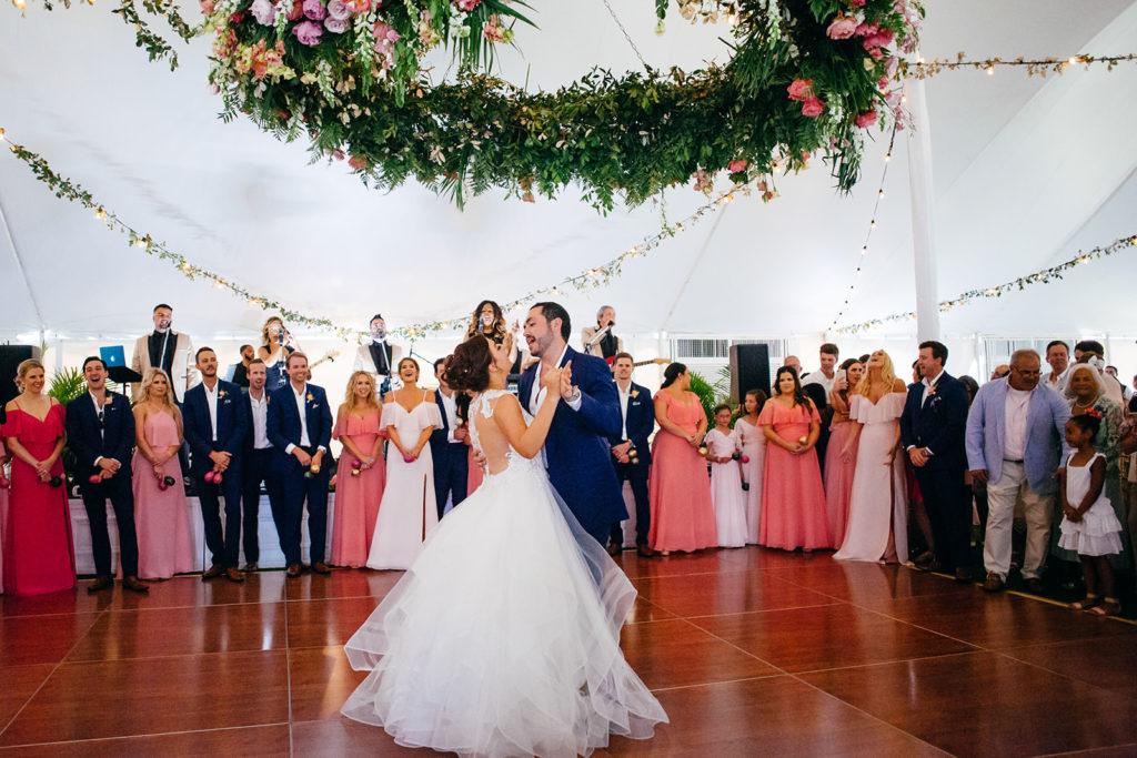 Tropical Bride and Groom Dancing in Tent Wedding Reception