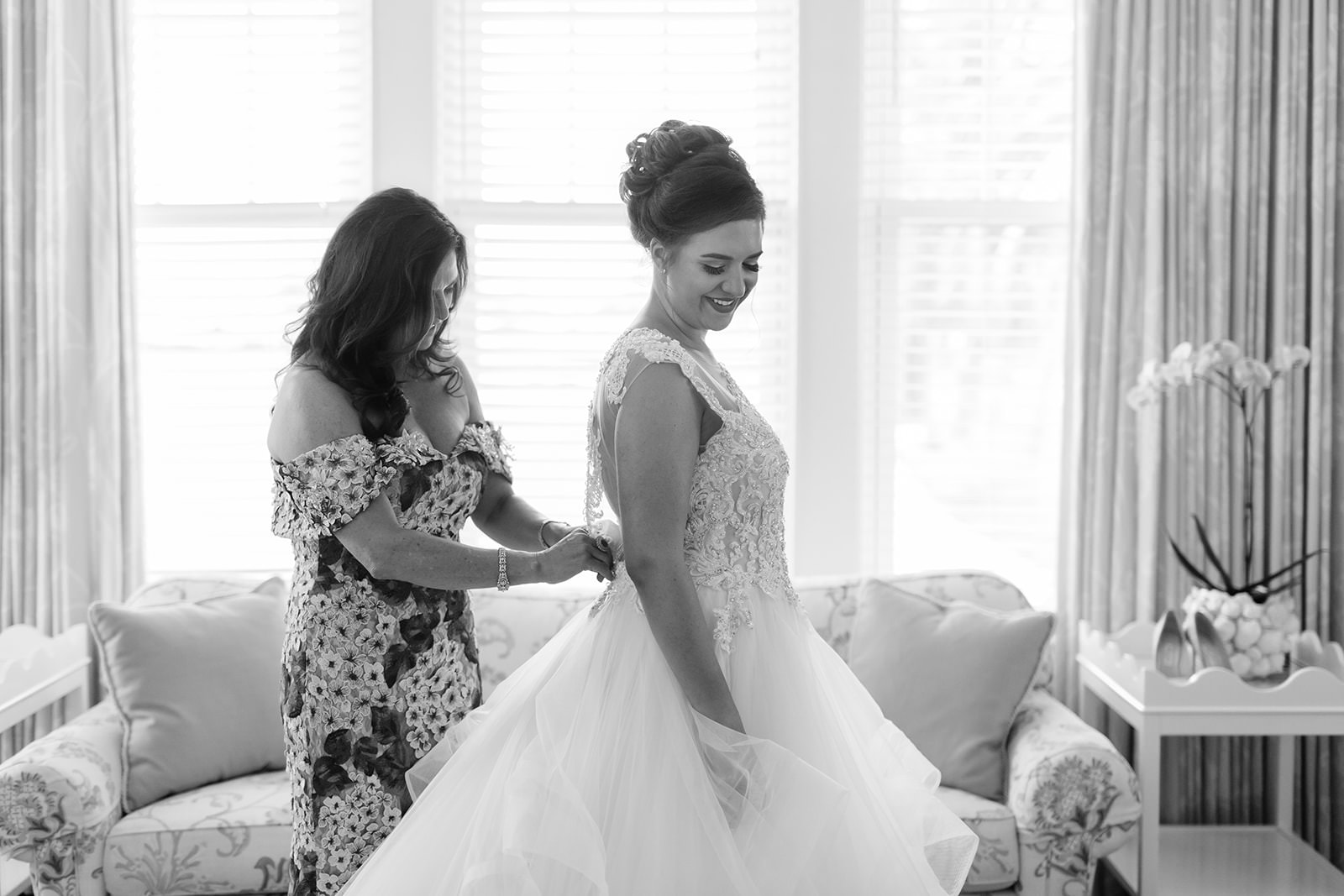 Tampa Bride Getting Ready Photo Putting on Sottero and Midgely Lace and Illusion Bodice and Tulle Skirt Ballgown Wedding Dress