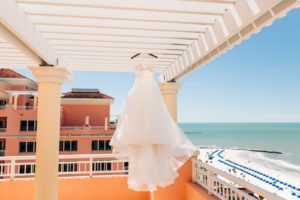 Florida Beachfront Wedding Venue with Hanging Mikaella Bridal Dress Full Tulle Skirt and Floral Lace Appliqué Bodice | Hyatt Regency Clearwater Beach