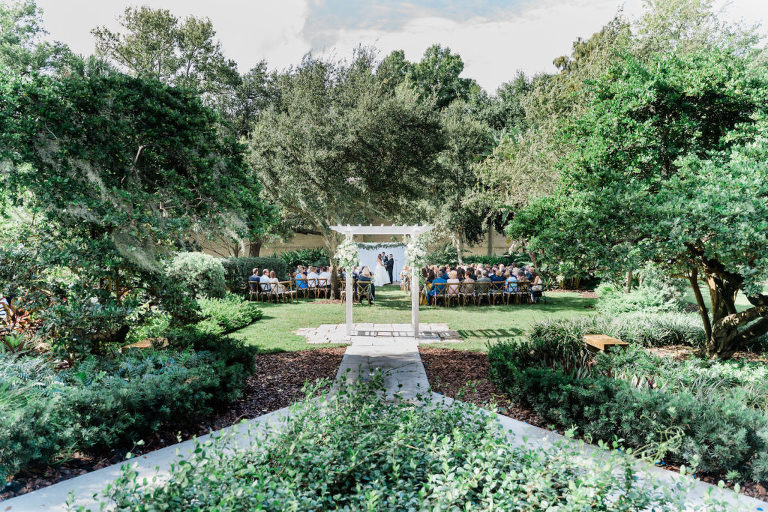Outdoor Ceremony with Cross Back Wood Chairs at Tampa Wedding Venue Tampa Garden Club