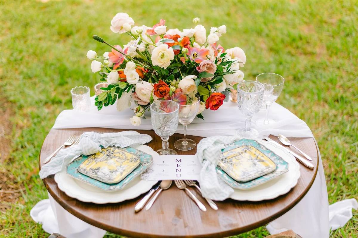 Tampa Bay Private Residence Wedding, Romantic Backyard Intimate Reception with Antique Wooden Household Furniture for Sweetheart Table, Decorated with Lush Bridal Bouquet with Triadic Color Scheme, pink, peach and ivory florals, Yellow and Turquoise China Plates, White Linen Draping, Eclectic Chargers and Table Scape with Crystal Goblets and Knotted Linens | Tampa Bay Wedding Planner, Designer, Florist John Campbell Weddings | Styled Shoot