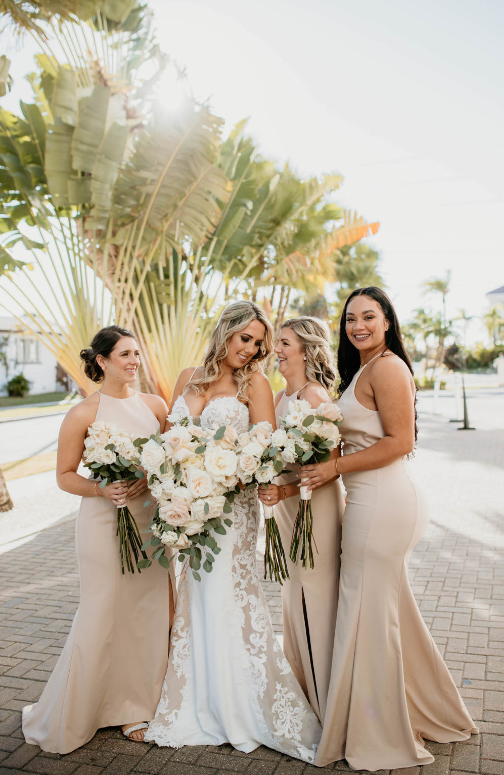 St. Petersburg Bride in Romantic Sweetheart V Neck Lace and Illusion Spaghetti Strap Wedding Dress Holding Lush White, Ivory and Blush Pink Roses and Eucalyptus Floral Bouquet, Bridesmaids in Beige Matching Dresses