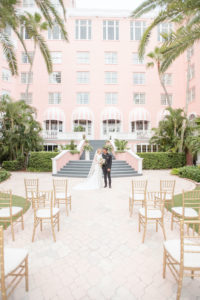 Bride and Groom in Courtyard of St. Petersburg Historic Wedding Venue The Pink Palace, Don Cesar | Tampa Bay Wedding Planner Elegant Affairs by Design | Styled Shoot