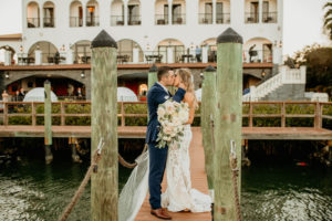 Romantic Intimate Bride and Groom on Waterfront Dock Kissing, Bride Holding Lush White, Ivory and Blush Pink Roses and Eucalyptus Floral Bouquet   St. Pete Boutique Hotel Wedding Venue Hotel Zamora