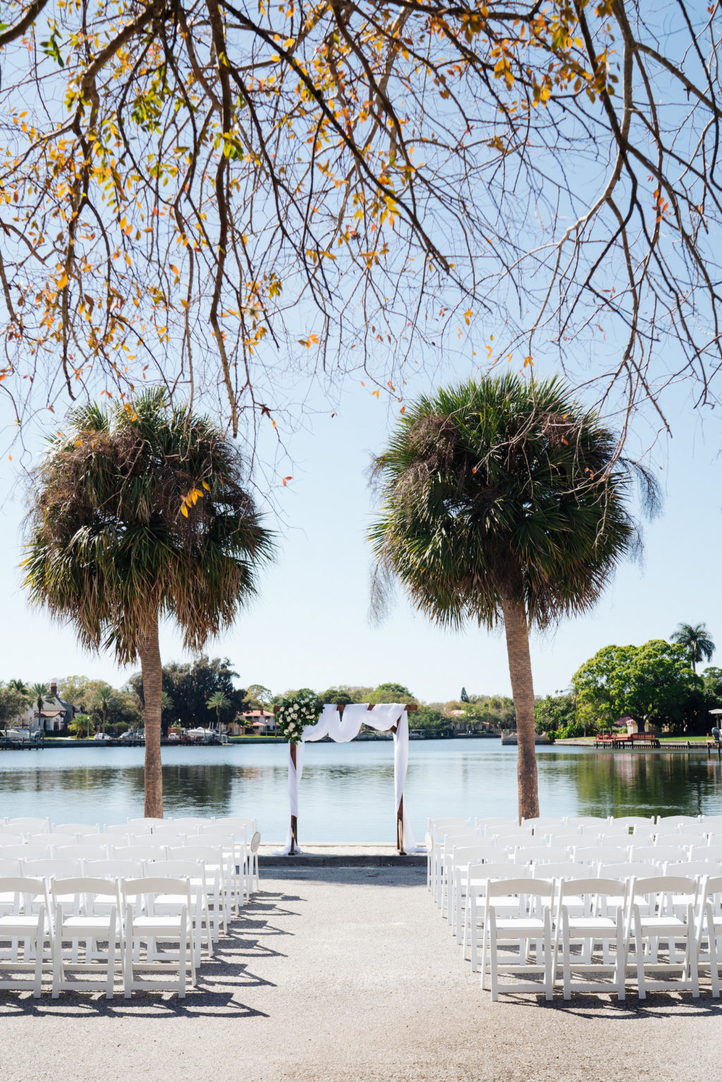 Florida Waterfront Wedding Ceremony, Lakeside Ceremony with Wooden Arch and White Draping | Tampa Bay Wedding Day of Coordinator Special Moments Event Planning | Florida Wedding Venue St. Petersburg Women's Club | Grind & Press Photography