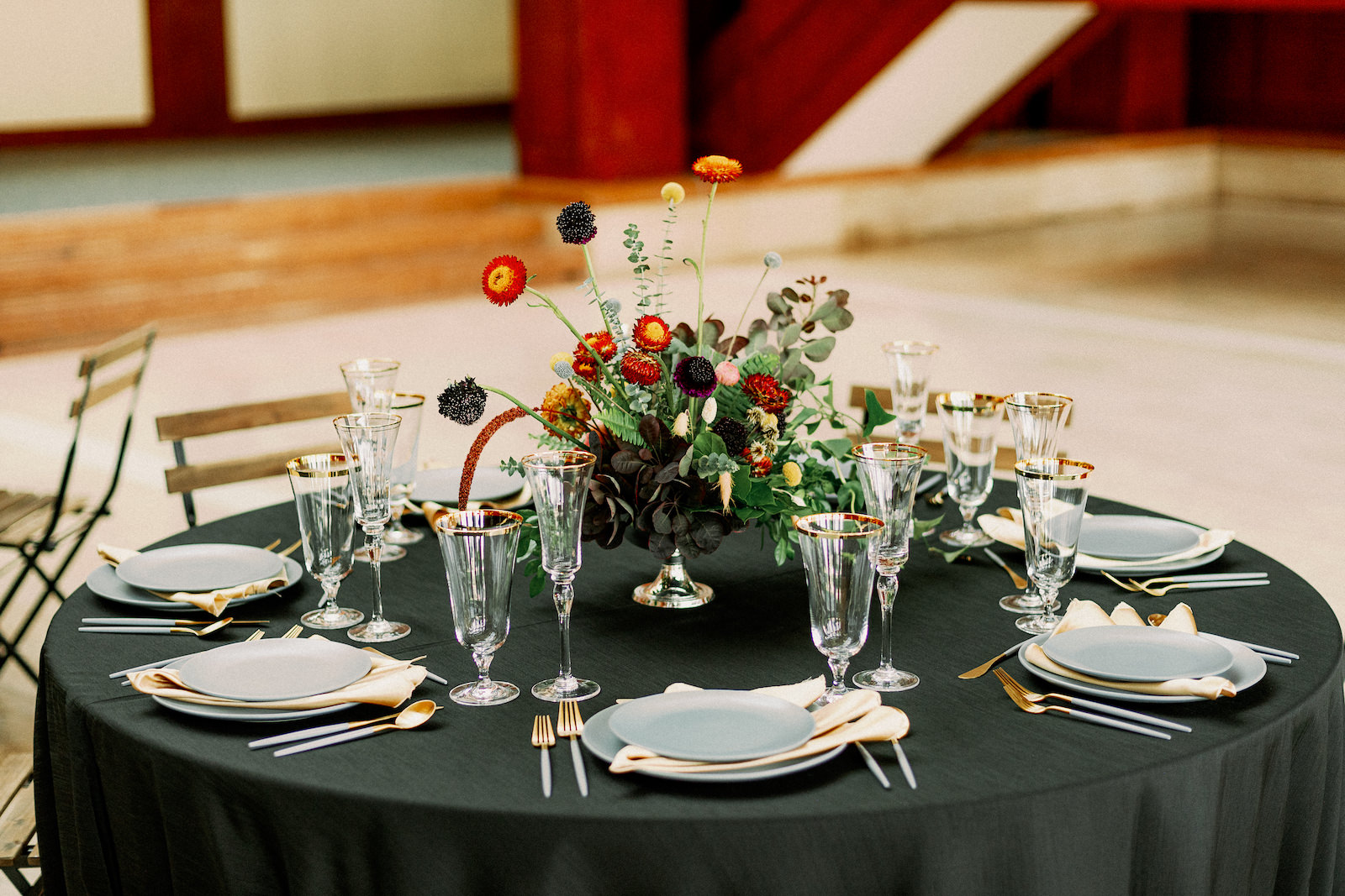 Intimate COVID Elopement Micro Wedding Reception Table with Black Linens and Grey Plates and Gold Flatware and Glassware by Kate Ryan Event Rentals   Black and Burgundy Maroon and Gold Wedding   Asymmetrical Unique Ikebana Fall Floral Arrangement by Tampa Wedding Florist Brides n Blooms   Winsor Event Studio