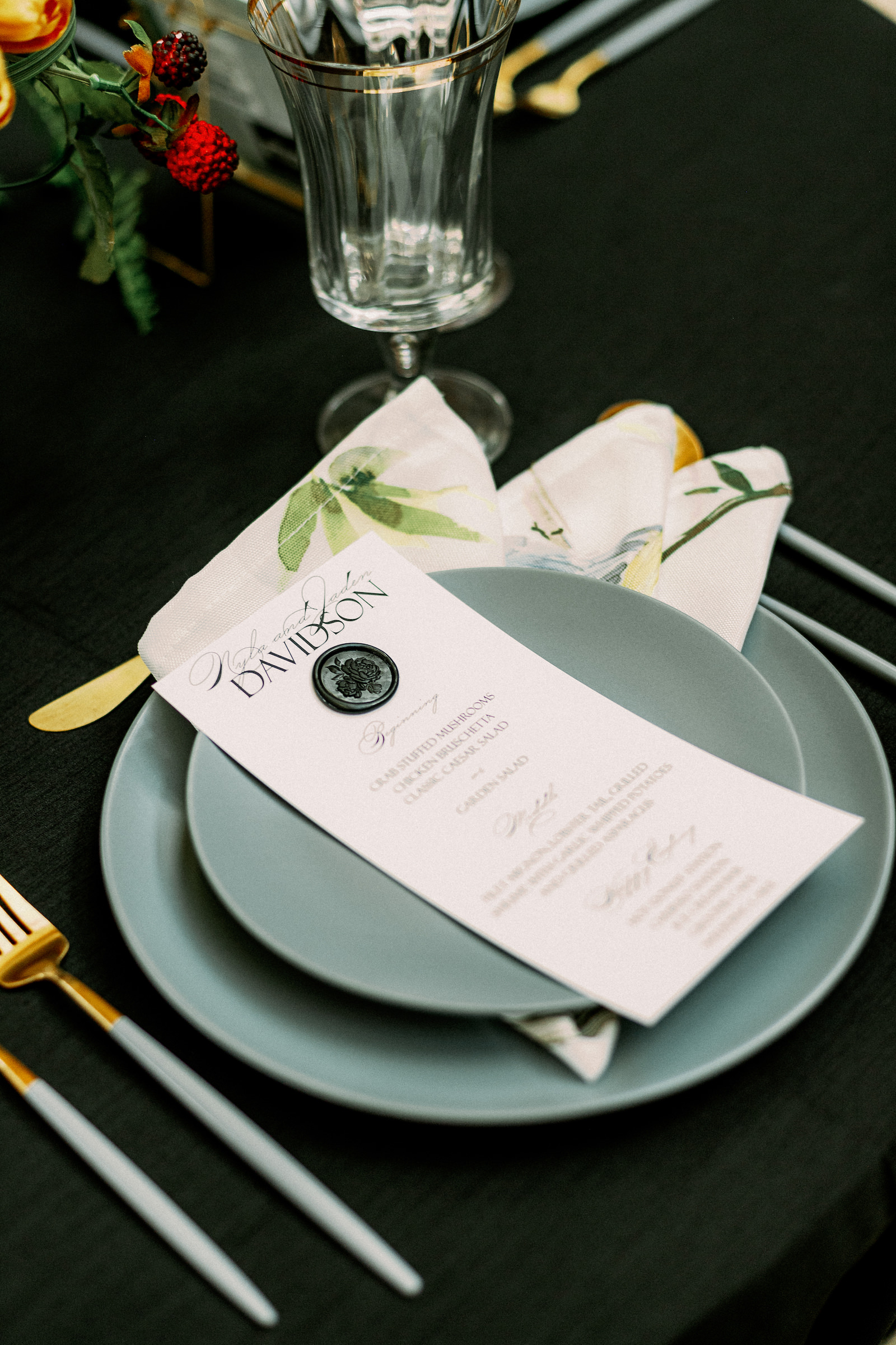 Wedding Menu Card with Wax Seal   Wedding Reception Table with Black Linens and Grey Plates and Gold Flatware and Glassware by Kate Ryan Event Rentals   Black and Burgundy Maroon and Gold Wedding   Winsor Event Studio