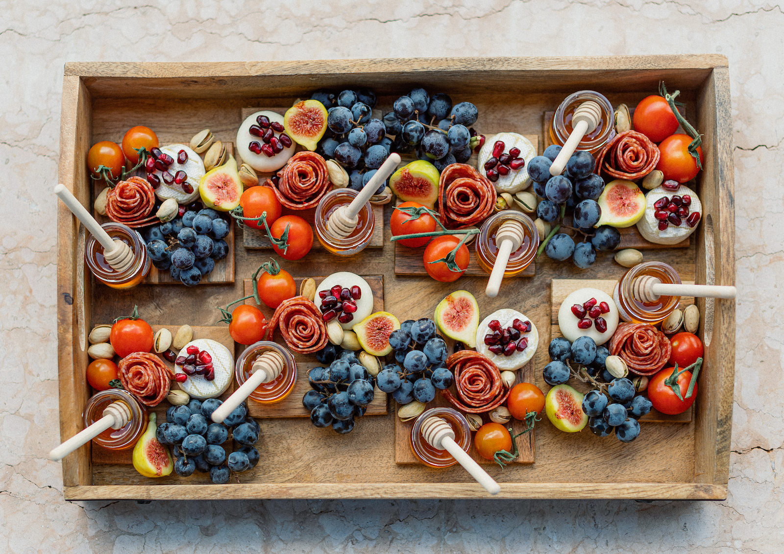Intimate COVID Elopement Micro Wedding Cocktail Hour Hors D'oeuvre Idea   Mini Grazing Board Display   Personal Cheese and Charcuterie Trays with Mini Brie and Mini Honey Jars with Salami Roses Figs Cherry Tomato Pistachios and Grapes