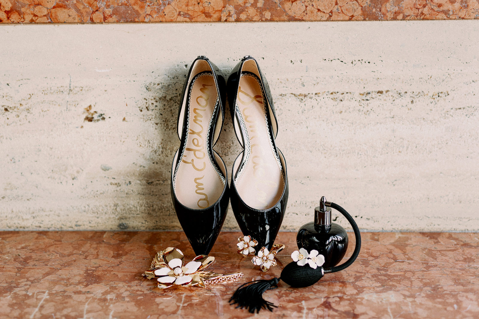 Wedding Bridal Accessories Patent Leather Black Designer Flats by Sam Edelman   Black Perfume Bottle with White and Gold Flower Statement Necklace Cuff Bracelet and Stud Earrings Wedding Jewelry