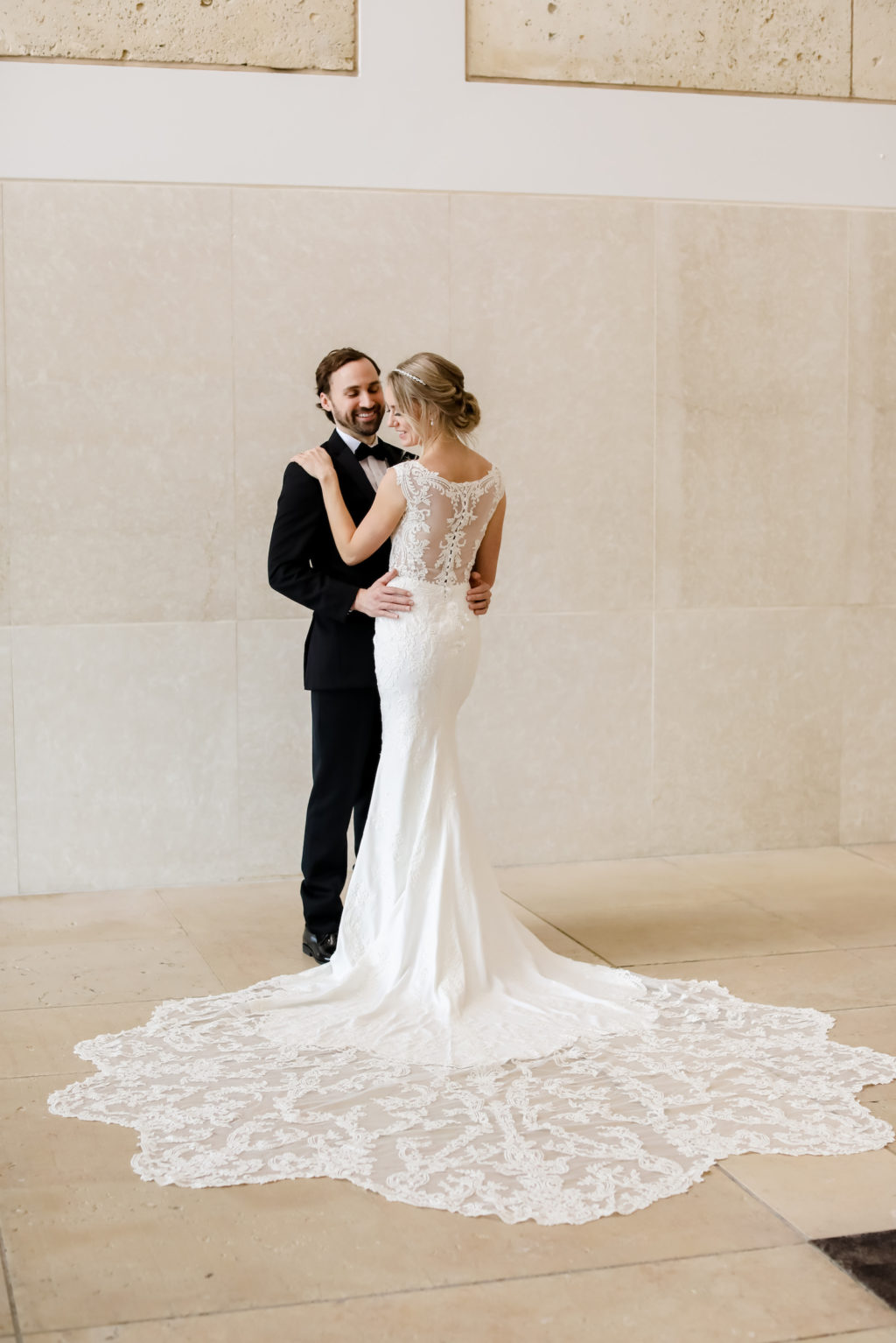 Classic bride in lace and illusion wedding dress with romantic train and groom in black tuxedo   Tampa Bay Wedding Dress and Tux Truly Forever Bridal   Tampa Bay Wedding Hair and Makeup Femme Akoi Beauty Studio   Wedding Photographer Lifelong Photography Studio   Styled Shoot