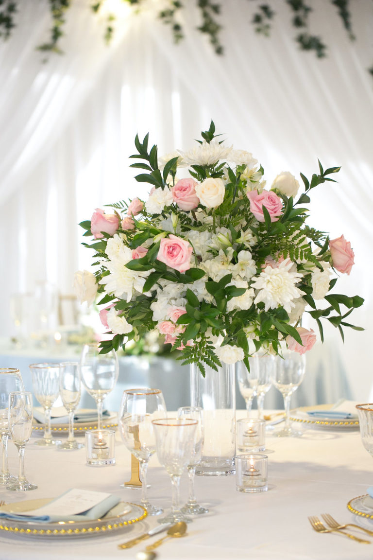 Elegant Modern Wedding Reception Decor, White Draping, Lush Pink and White Florals with Greenery Centerpiece, Gold Beaded Chargers and Flatware | Tampa Bay Wedding Photographer Carrie Wildes | Wedding Planner Coastal Coordinating | Wedding Rentals Outside the Box | Wedding Florist Brides N Blooms