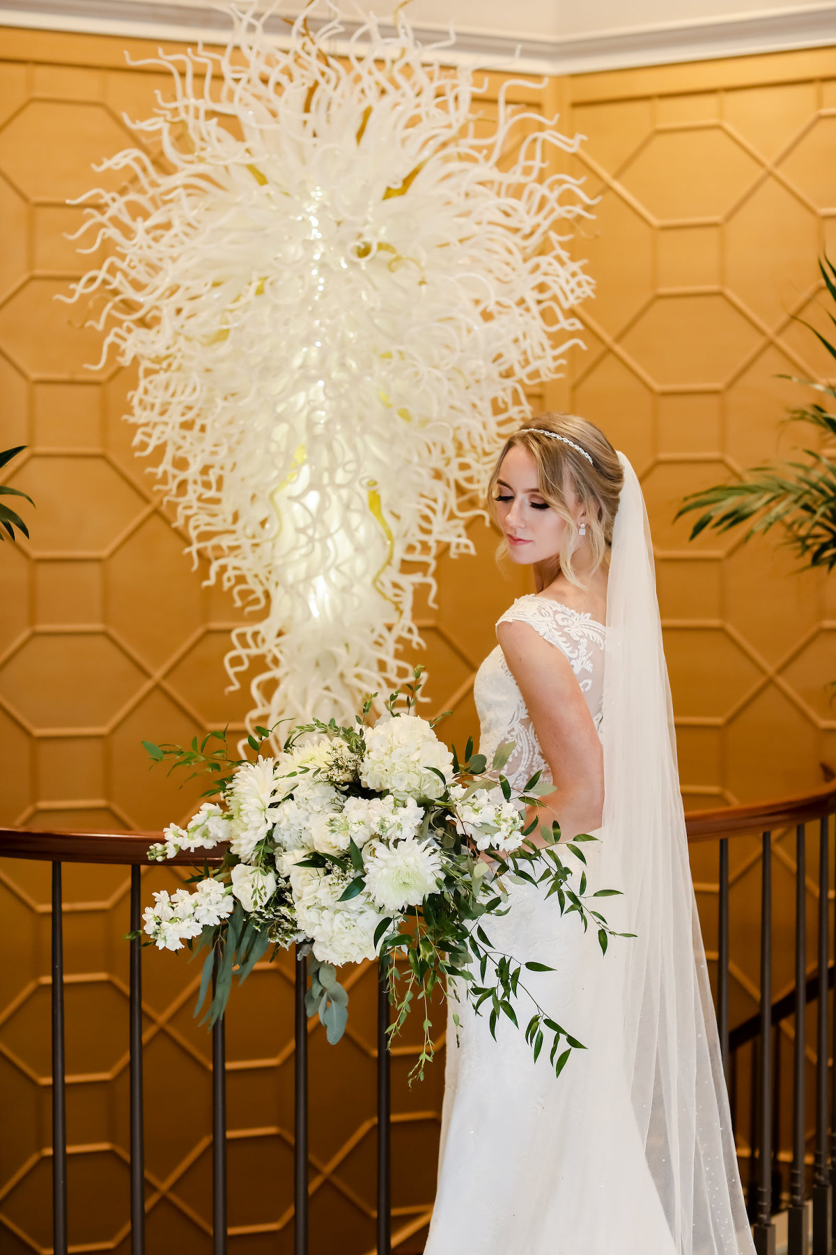 Romantic Traditional Bride with Full Length Veil Holding White and Greenery Floral Lush Bouquet | Wedding Venue The Tampa Club | Wedding Hair and Makeup Femme Akoi Beauty Studio | Wedding Dress Truly Forever Bridal | Wedding Photographer Lifelong Photography Studio | Styled Shoot