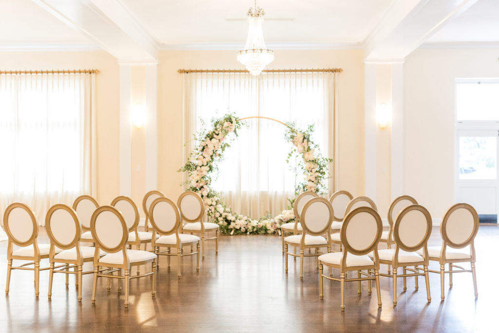 Southern charm classic wedding ceremony decor, circular arch with white lush floral bouquets, crystal chandelier and Louis XVI chairs | Tampa Bay wedding planner and design Elegant Affairs by Design | Kate Ryan Event Rentals