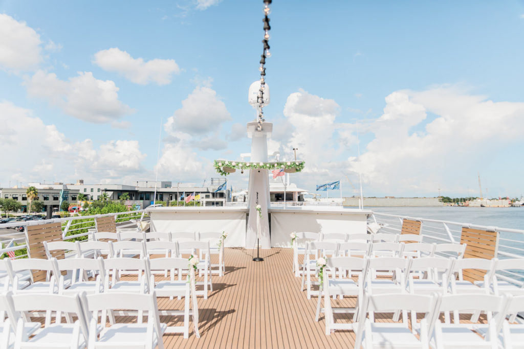 Tampa COVID Wedding at Yacht Starship Venue | Waterfront Wedding Ceremony Ship Boat Deck with White Folding Garden Chairs and Greenery Garland