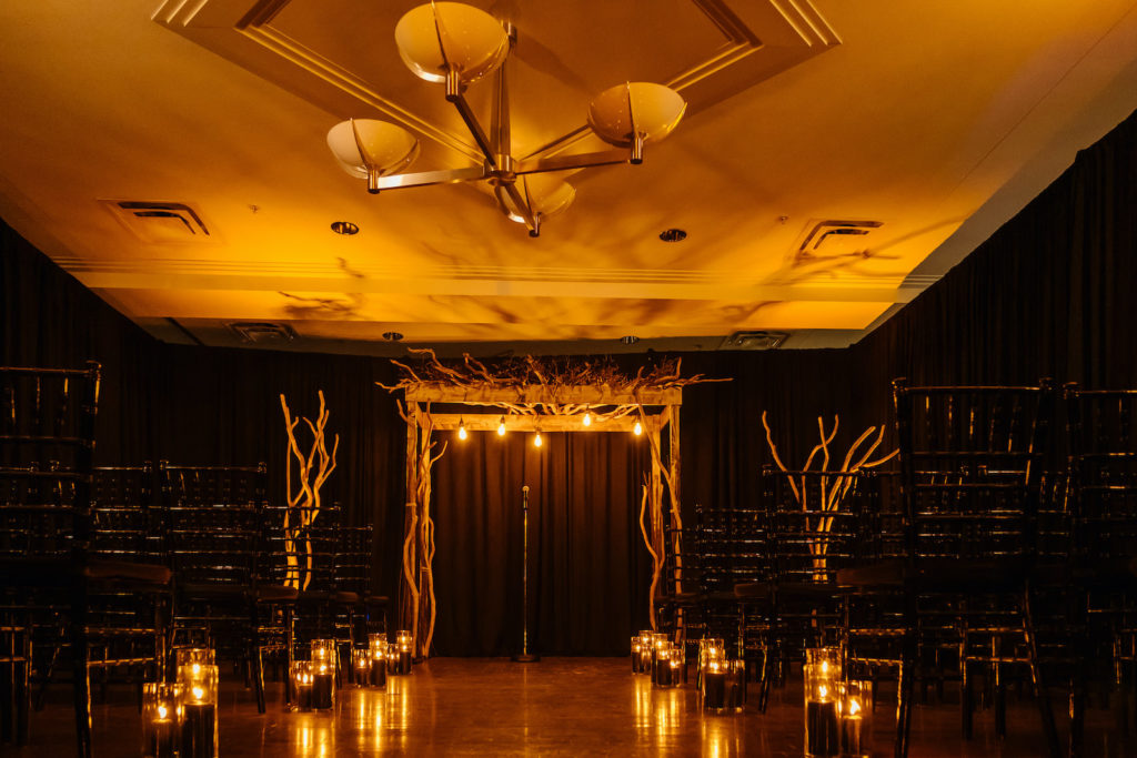 Whimsical Halloween Wedding Ceremony Decor, Tree Branches Arch, Black Candles in Hurricane Candle Holders | Tampa Bay Wedding Planner UNIQUE Weddings and Events | Wedding Rentals A Chair Affair