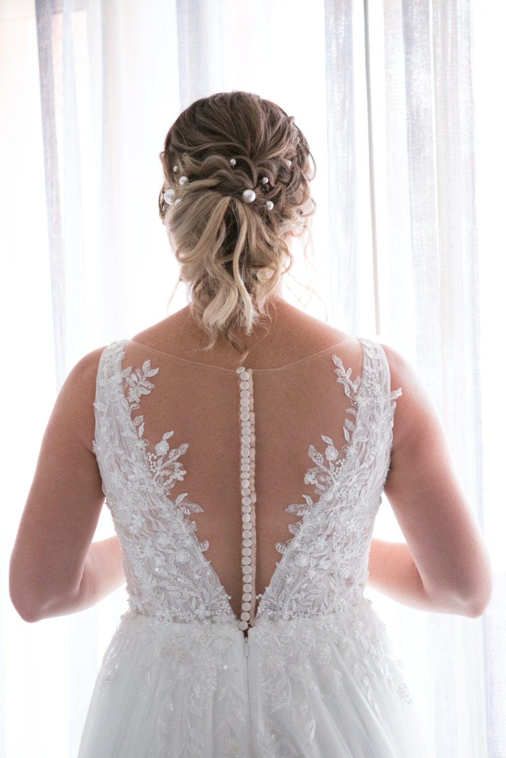 Clearwater Beach Bride in Delicate Floral Lace, Illusion V Back and Rhinestone Buttons, Updo Hairstyle with Pearls   Tampa Bay Wedding Photographer Carrie Wildes   Wedding Hair and Makeup Femme Akoi Beauty Studio   Wedding Dress Truly Forever Bridal