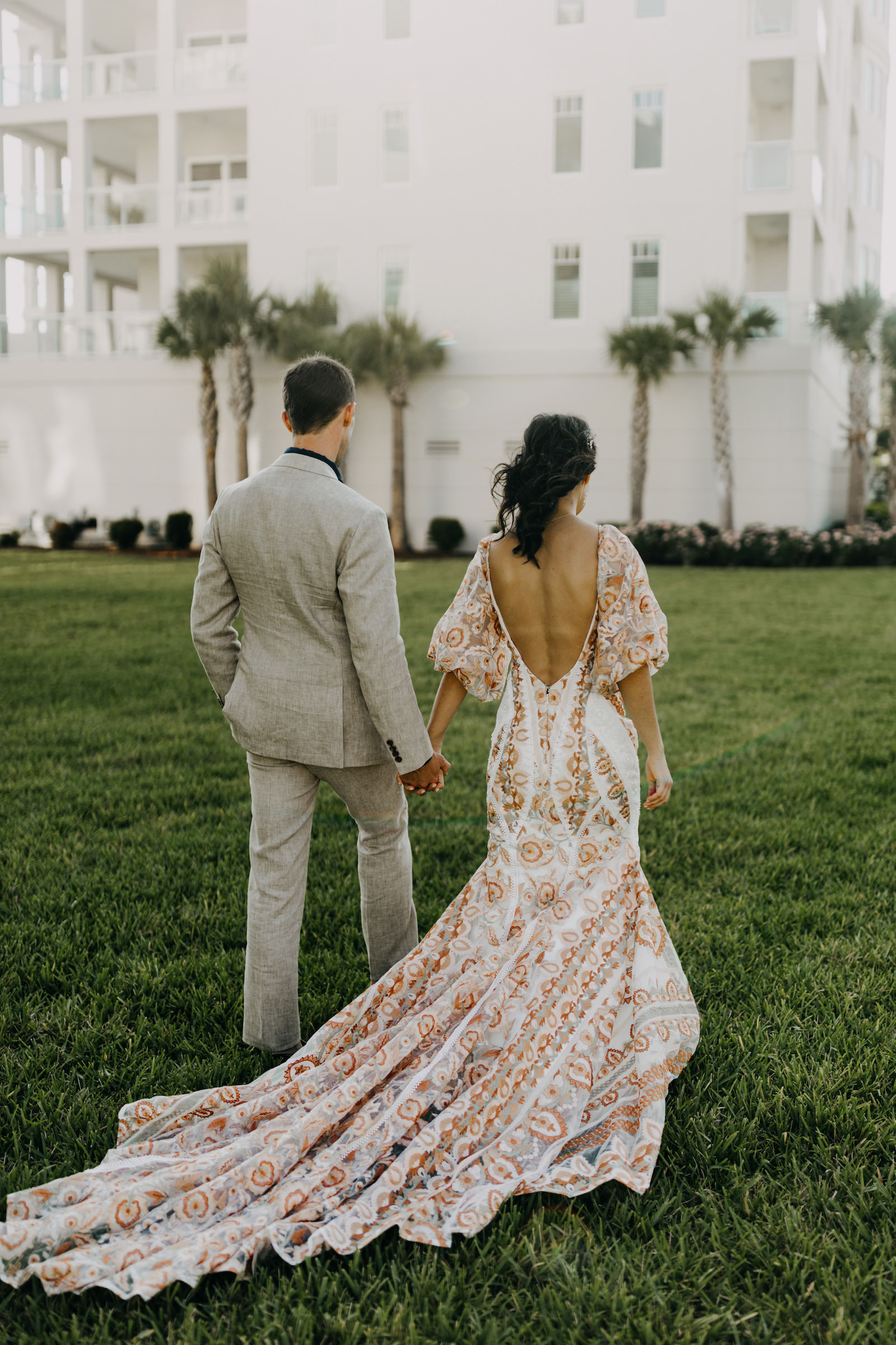 Outdoor Bride and Groom Portrait   Boho Gold Bronze Embroidered Overlay Wedding Dress Bridal Gown with Illusion Sleeves and Train   Groom in Grey Khaki Linen Suit   Amber McWhorter Photography