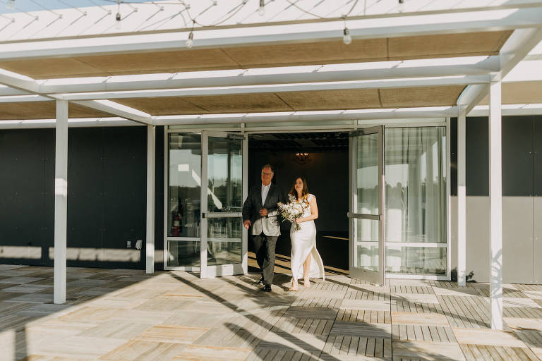 Neutral Modern Bride Holding All White Floral Bouquet Walking Down the Wedding Ceremony Aisle with Father | Tampa Bay Wedding Photographer Amber McWhorter | Wedding Planner Elope Tampa Bay