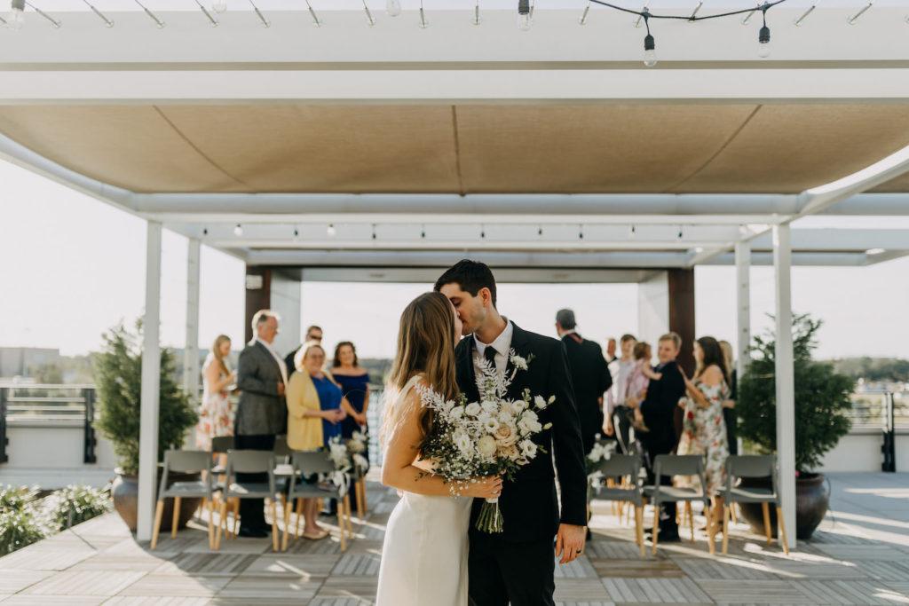 Modern Industrial Bride and Groom Wedding Ceremony Exit Photo | Tampa Bay Wedding Venue Rooftop 220 | Wedding Planner Elope Tampa Bay | Wedding Photographer Amber McWhorter