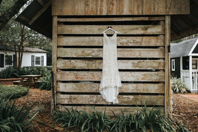 Wedding Dress Hanger Shot   V Neck Champagne Lace Bridal Gown Wedding Dress from Sarasota Dress Shop Truly Forever Bridal   Custom Name Hanger on Rustic Wood Plank Wall