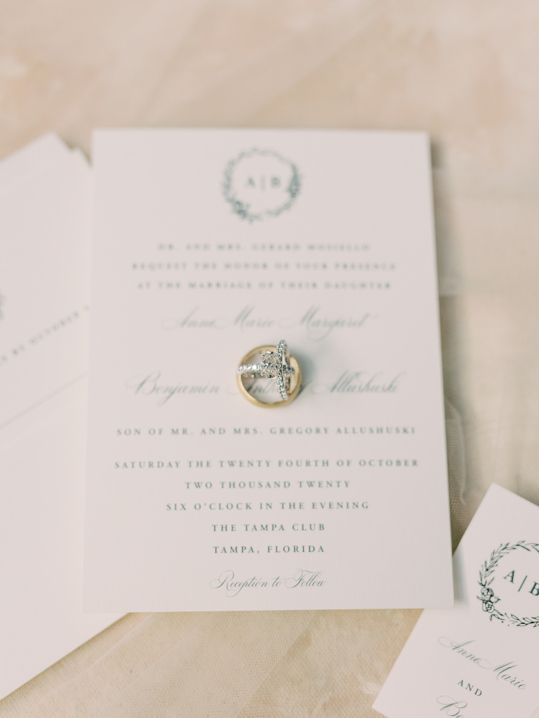 Traditional Tampa Wedding Invitation with Floral Halo Monogram in Dusty Blue Ink with Calligraphy | Wedding Ring Shot With Stationary | Oval Diamond Tiffany Solitaire Engagement Ring with Channel Set Diamond Band