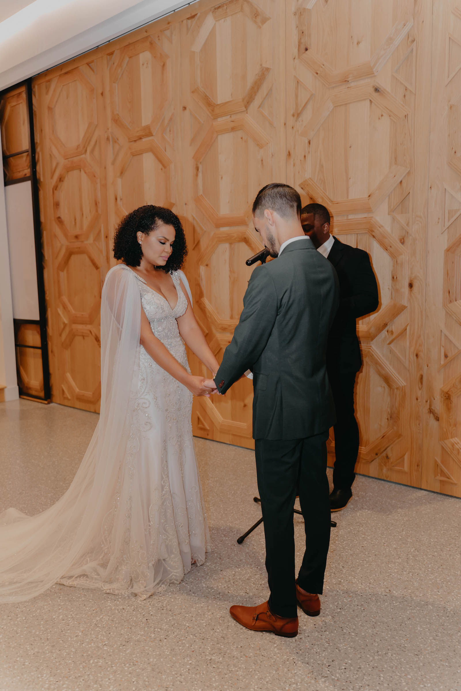 Indoor Wedding Ceremony in Tampa Wedding Venue Hyde House   Illusion Lace Embroidered Beaded V Neck Wedding Dress Bridal Gown with Sheer Tulle Cape Sleeves by Designer Amalia Carrara Bridal