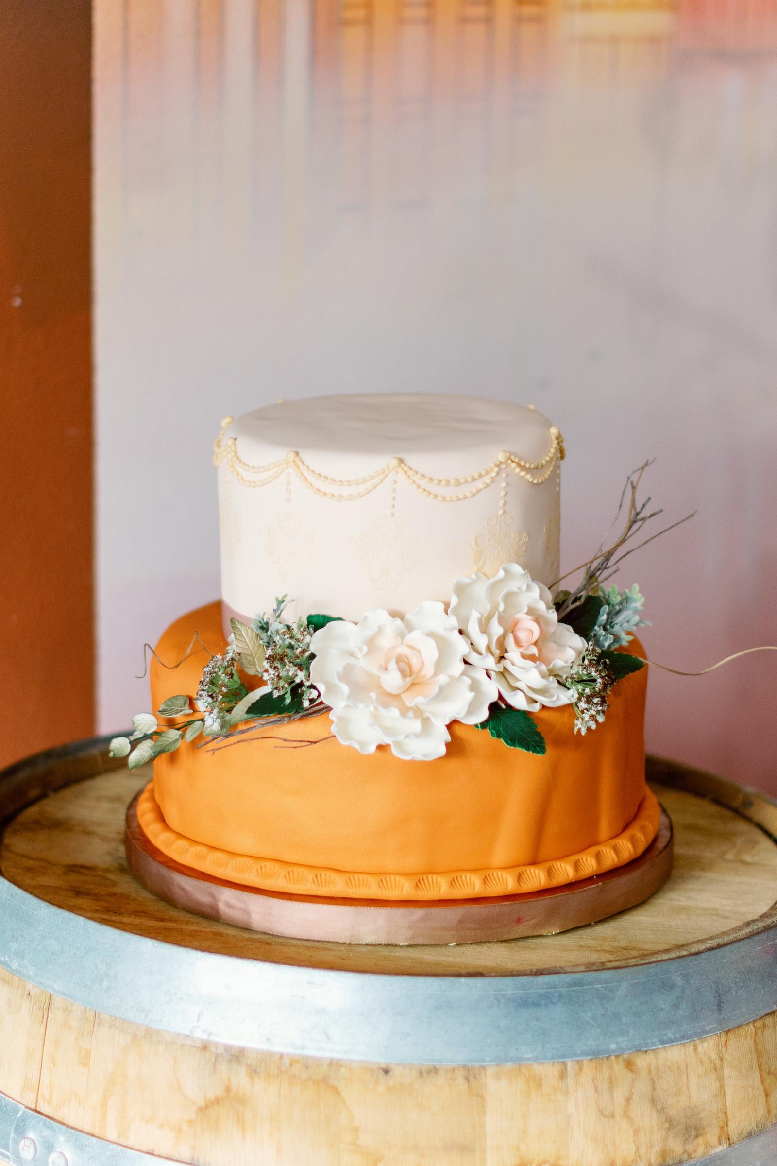 Modern Boho Two Tier White and Orange Wedding Cake with Sugar Flowers