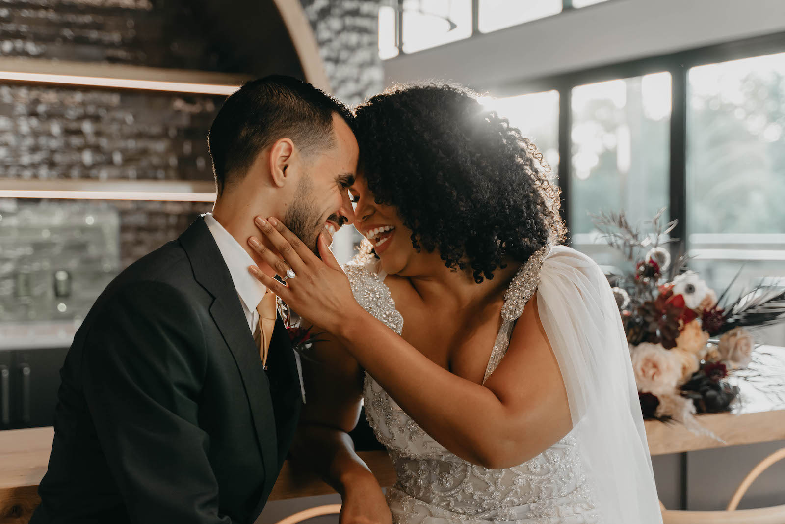 Indoor Bride and Groom Portrait in Tampa Wedding Venue Hyde House   Illusion Lace Embroidered Beaded V Neck Wedding Dress Bridal Gown with Sheer Tulle Cape Sleeves by Designer Amalia Carrara Bridal   Groom in Classic Black Tux Suit with Gold Tie