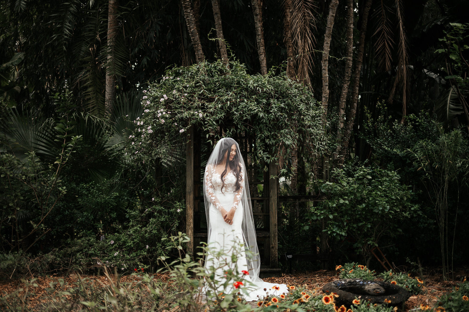 Tropical Elegant Inspired Florida Bride at Sunken Gardens in St. Petersburg, Bride Wearing BHLDN Wedding Dress with Long Illusion Lace Sleeves with Veils | Tampa Bay Wedding Planner John Campbell Weddings