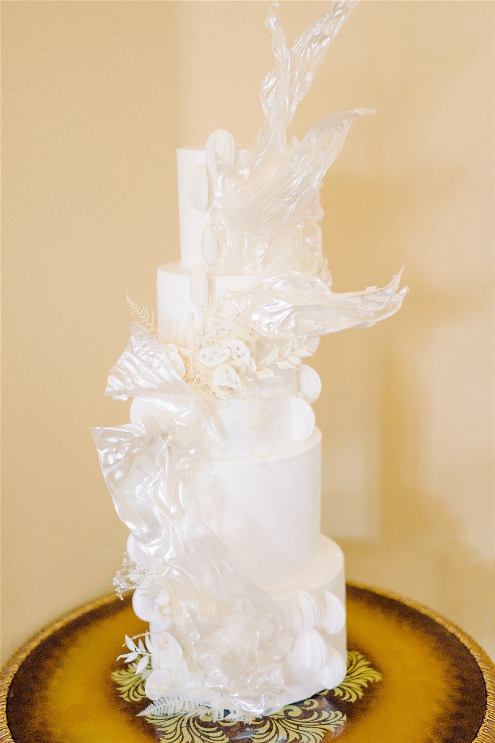 Modern All White Wedding Cake with Sugar Sculpture from Tampa Bay Baker The Artistic Whisk