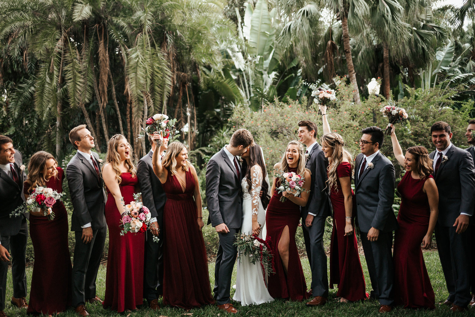 St. Petersburg Wedding Party, Bridal Bouquet with Exotic Tropical Inspired Flowers, White, Dark Purple, Burgundy, Wine Florals with Greenery, Bridesmaids in Long Mismatched BHLDN Dresses in Dark Burgundy and Wine Color | Florida Wedding Florist Posies Flower Truck | Tampa Bay Wedding Planner John Campbell Weddings