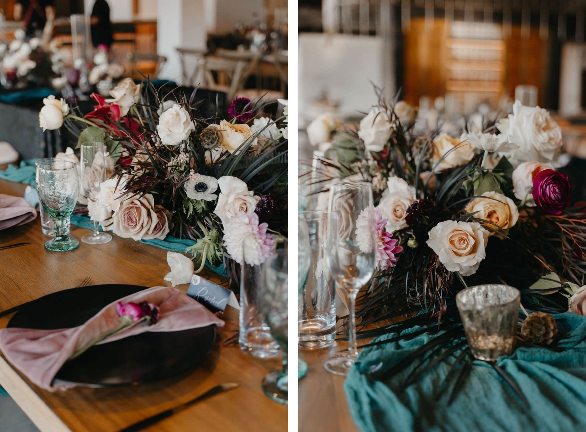 Wedding Reception Centerpiece with Dark Emerald Green Cheesecloth Gossamer Runners and Mauve Blush Pink Velvet Napkins on Black China Plates   Low Boho Centerpieces with Dark Green and Black Leaves, Scabiosa Pods, Pink Dahlias and Ranunculus, and Blush Cafe au Lait Roses
