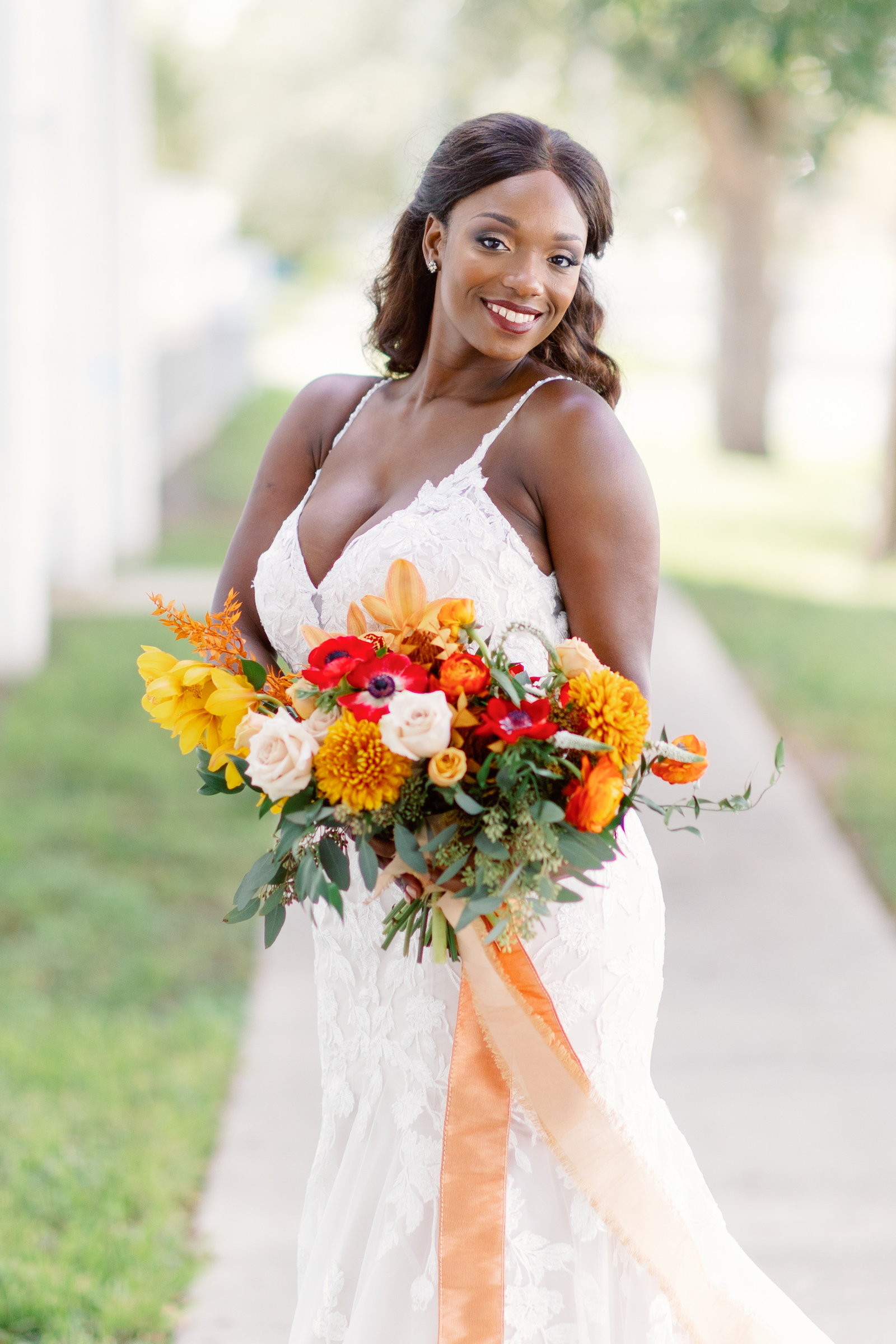 Modern Boho Florida Bride Holding Bridal Bouquet, Wearing White Mermaid Style Wedding Gown with V Neckline and Straps, Autumn-Inspired Wedding Bouquet, Holding Triadic Orange Color Palette, Red Posies, Yellow Flowers, Ivory Roses, Orange Florals with Dark Greenery   Tampa Bay Wedding Planner Coastal Coordinating, Jessica Zenobi