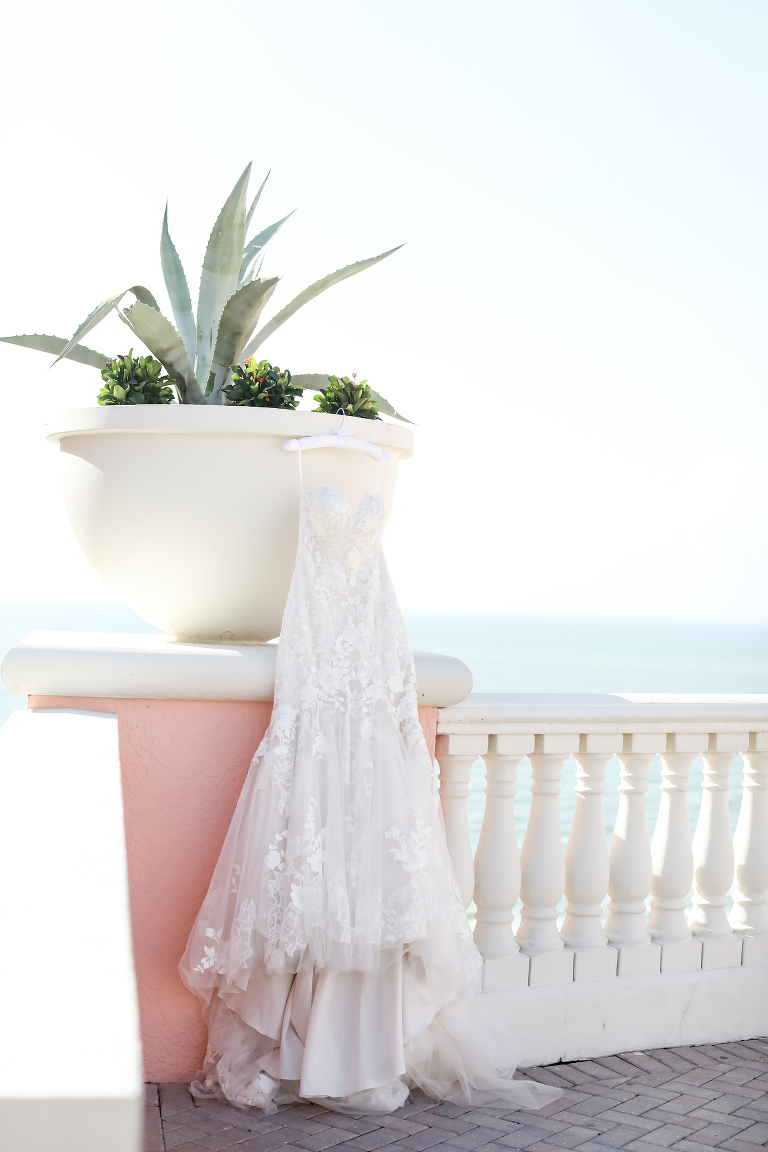 Outdoor Wedding Dress Hanger Shot at Clearwater Wedding Venue Hyatt Regency Clearwater Beach | Strapless Lace Sweetheart Mermaid Wedding Dress Bridal Gown