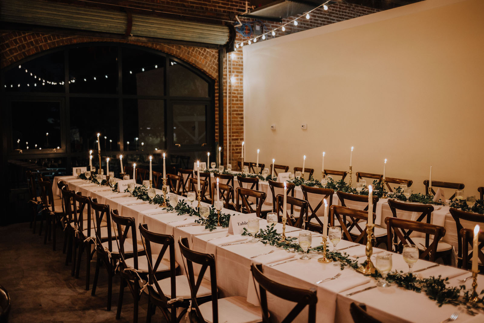 Rustic Boho Wedding Reception Feasting Tables with Gold Candle Centerpieces, Greenery Garland, and French Country Chairs | St. Pete Wedding Florist Posies Flower Truck