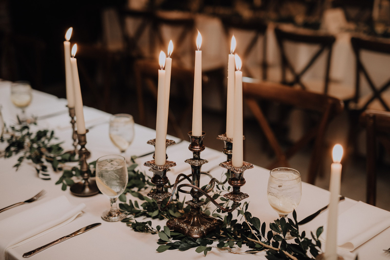 Rustic Boho Wedding Reception Feasting Tables with Gold Candle Centerpieces, Greenery Garland | St. Pete Wedding Florist Posies Flower Truck
