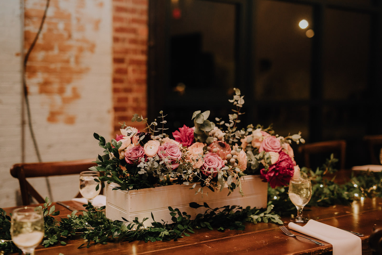 Rustic Boho Wedding Reception with Boxed Red and Pink Floral Centerpieces and Greenery Garland | St. Pete Wedding Florist Posies Flower Truck