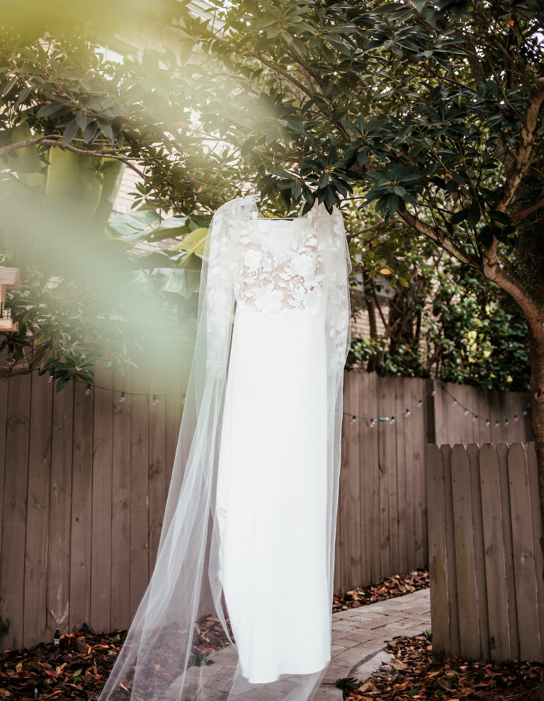 Modern Tropical Wedding Dress Hanging From Tree, BHLDN Long Sleeve Illusion Lace Dress