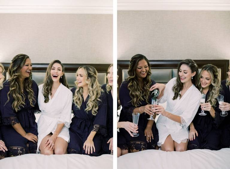 Bride and Bridesmaids Getting Ready in Navy Blue and White Robes with Flutes of Bubbly Champagne