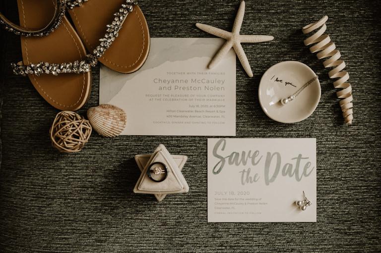 Coastal Beach Wedding Invitation Flat Lay with Silver Grey Font Stationery and Sea Shells Starfish