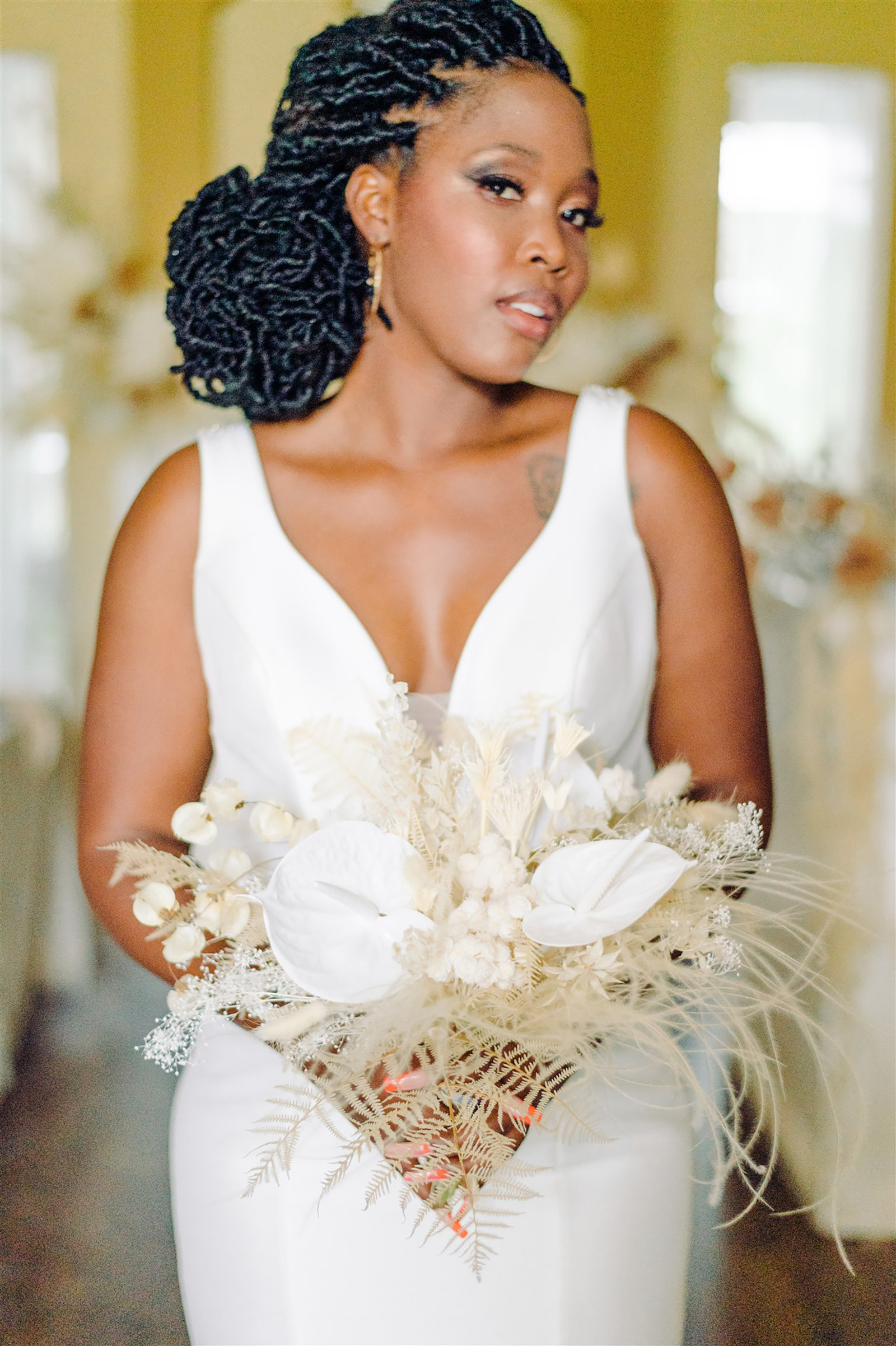 Bride in Classic V Neck Fitted Wedding Dress Holding White Preserved Flowers and Foliage, Feathers, Floral Bouquet | Tampa Bay Wedding Planner, Florist and Designer John Campbell Weddings | Wedding Hair and Makeup Michele Renee the Studio