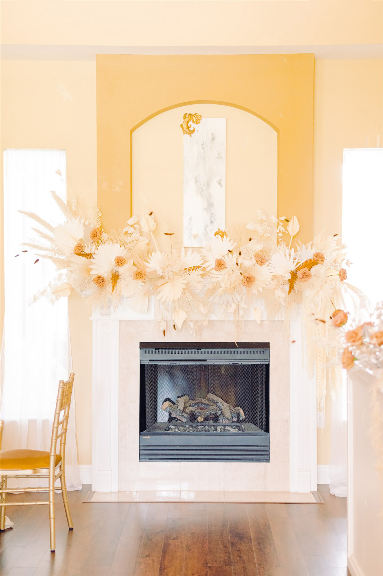 Trendy and Modern Boho Wedding Decor, White and Beige Preserved Florals and Foliage Bouquet on Fireplace Mantel | Tampa Bay Wedding Planner, Florist and Designer John Campbell Weddings
