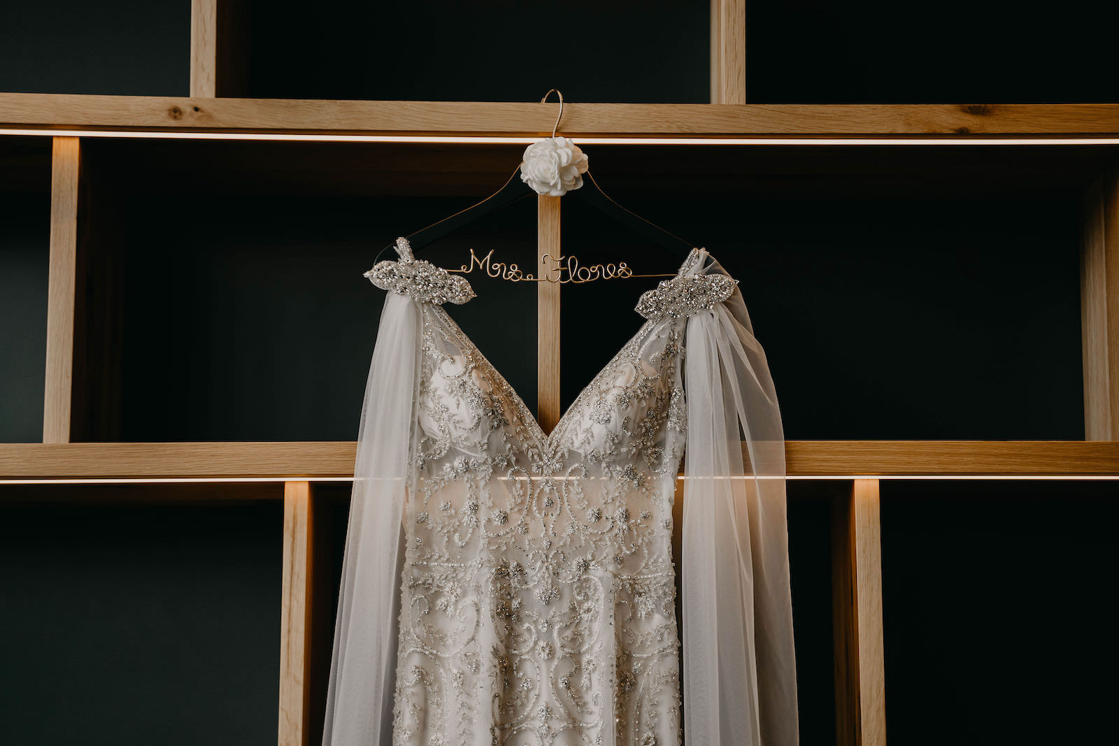 Wedding Dress Hanger Shot   Custom Name Wire Hanger   Illusion Lace Embroidered Beaded V Neck Wedding Dress Bridal Gown with Sheer Tulle Cape Sleeves by Designer Amalia Carrara Bridal