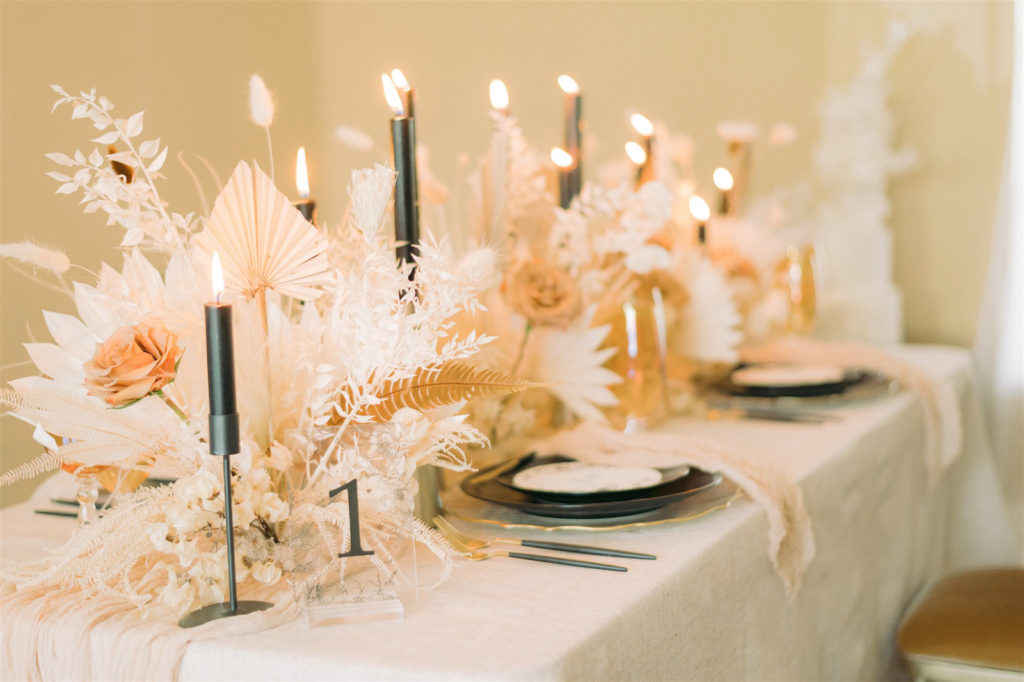 Modern Boho Wedding Reception Decor, Dried Preserved Flower Bouquets, White Feathers, Leaves and Flowers, Black Taper Candlesticks, Black Chargers, White Linens | Tampa Bay Wedding Planning, Design, Florals John Campbell Weddings | Tabletop Wedding Rentals Kate Ryan Event Rentals | Styled Shoot