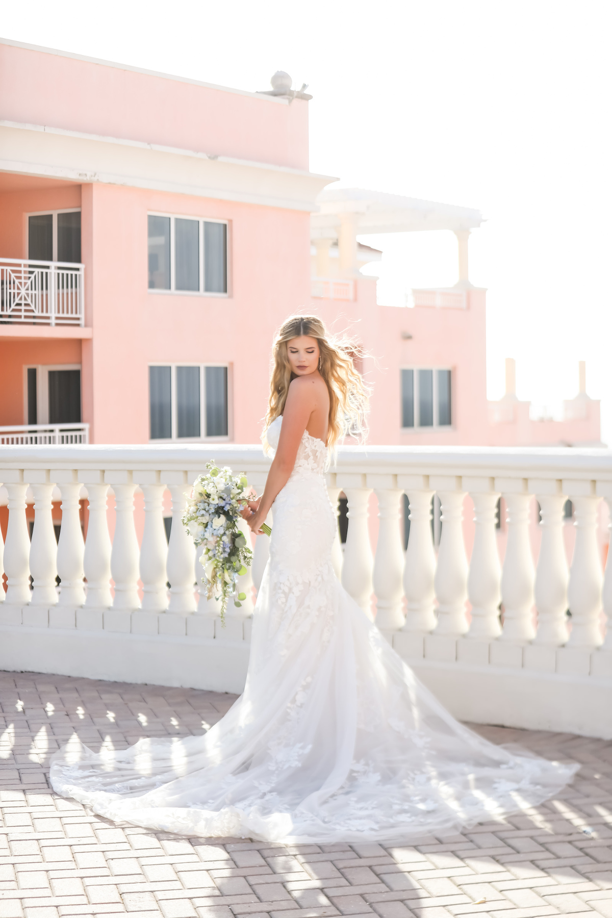 Outdoor Bridal Portrait at Clearwater Wedding Venue Hyatt Regency Clearwater Beach | Strapless Lace Sweetheart Mermaid Wedding Dress Bridal Gown | Lifelong Photography Studio