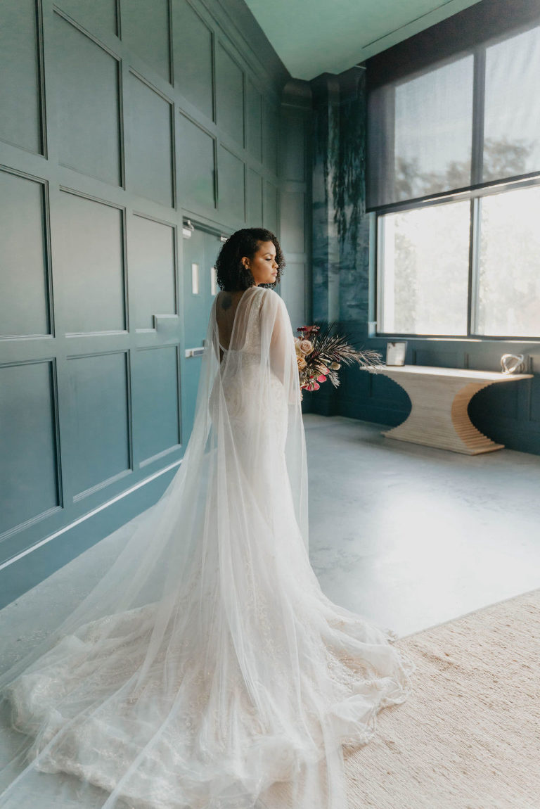 Indoor Bridal Portrait in Tampa Wedding Venue Hyde House   Illusion Lace Embroidered Beaded V Neck Wedding Dress Bridal Gown with Sheer Tulle Cape Sleeves by Designer Amalia Carrara Bridal