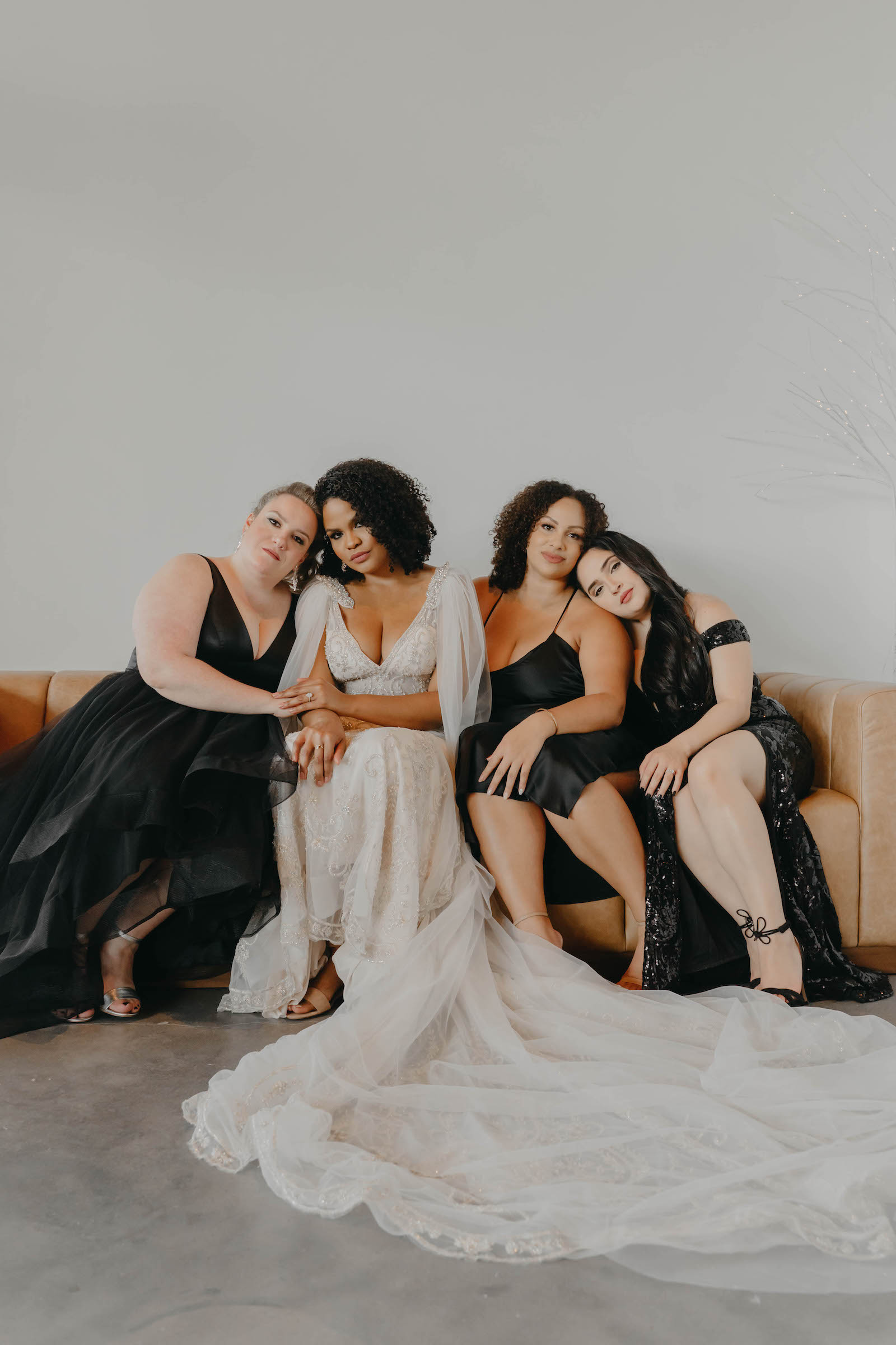 Indoor Bridal Party Portrait in Tampa Wedding Venue Hyde House   Illusion Lace Embroidered Beaded V Neck Wedding Dress Bridal Gown with Sheer Tulle Cape Sleeves by Designer Amalia Carrara Bridal   Black Formal Elegant Bridesmaid Dresses